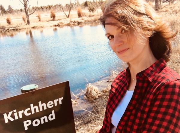 Kim Kirchherr by family pond